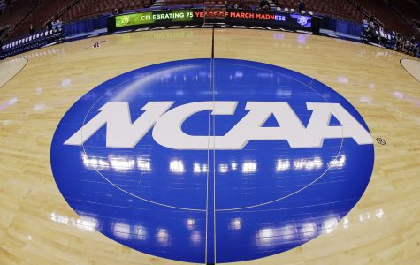 <![CDATA[FILE - In this March 21, 2013, file photo, in this image taken with a fisheye lens, the NCAA logo is displayed at mid-court before Albany's practice for a second-round game of the NCAA college basketball tournament in Philadelphia. Barely a month ago, the NCAA was shamed into apologizing for trying to rig its own investigation into funny business at the University of Miami. According to a new report, that apology didn't go nearly far enough. (AP Photo/Matt Slocum, File)]]>