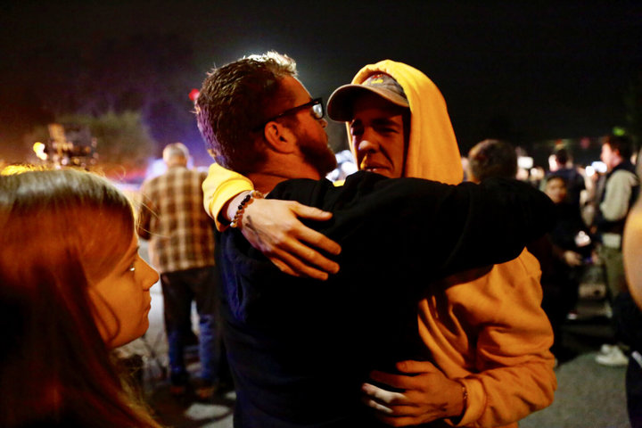 <![CDATA[THOUSAND OAKS, CA - NOVEMBER 08: Holden Harrah, 21, (R) who witnessed the shooting hugs family and friends after a shooter wounded seven Wednesday night on November 8, 2018 in Thousand Oaks, California. The gunman burst into the bar around 11:20 p.m., cloaked in all black as he threw smoke bombs and began shooting at targets as young as 18 inside the Borderline Bar & Grill, authorities and witnesses said. (Photo by Al Seib / Los Angeles Times via Getty Images)]]>