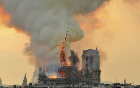 <![CDATA[In this image made available on Tuesday April 16, 2019 flames and smoke rise from the blaze as the spire starts to topple on Notre Dame cathedral in Paris, Monday, April 15, 2019. An inferno that raged through Notre Dame Cathedral for more than 12 hours destroyed its spire and its roof but spared its twin medieval bell towers, and a frantic rescue effort saved the monument's