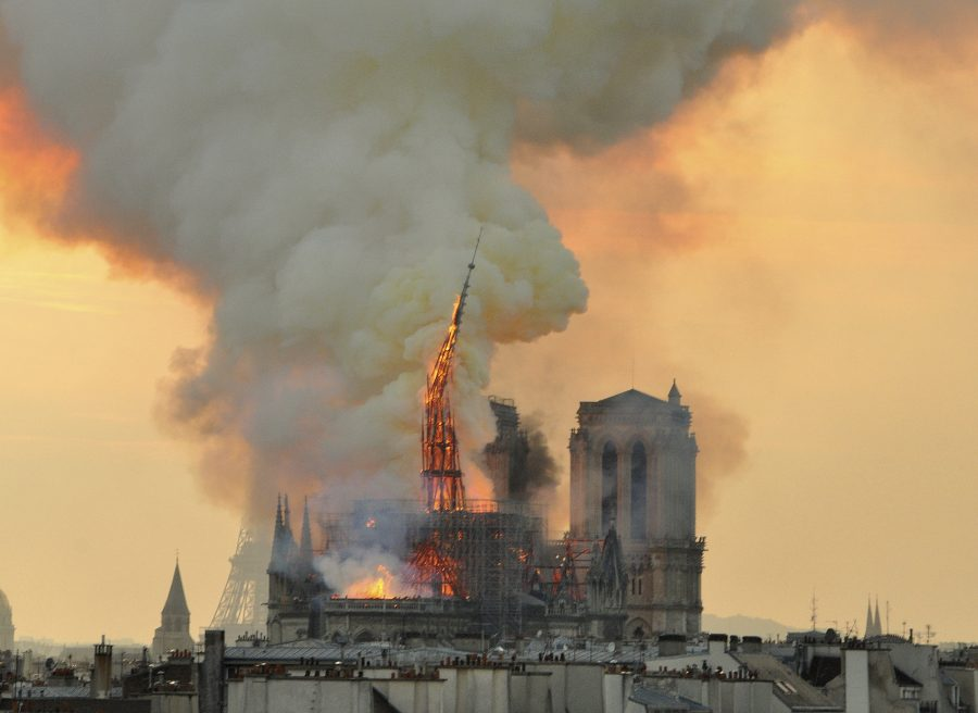 %0A%09%09%09%09%3C%21%5BCDATA%5BIn+this+image+made+available+on+Tuesday+April+16%2C+2019+flames+and+smoke+rise+from+the+blaze+as+the+spire+starts+to+topple+on+Notre+Dame+cathedral+in+Paris%2C+Monday%2C+April+15%2C+2019.+An+inferno+that+raged+through+Notre+Dame+Cathedral+for+more+than+12+hours+destroyed+its+spire+and+its+roof+but+spared+its+twin+medieval+bell+towers%2C+and+a+frantic+rescue+effort+saved+the+monument%27s+%22most+precious+treasures%2C%22+including+the+Crown+of+Thorns+purportedly+worn+by+Jesus%2C+officials+said+Tuesday.+%28AP+Photo%2FThierry+Mallet%29%5D%5D%3E%09%09