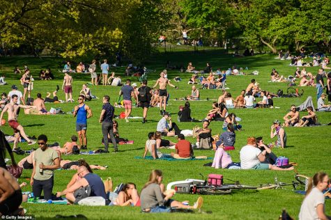 As the weather gets warmer, crowds form in public parks, defying the stay-at-home order