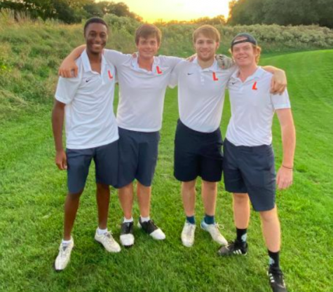 Last year's golf seniors, George, Rob, Mac, and Kendal, pose for a photo