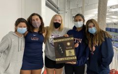 The Varsity Girls' Tennis Team with their Championship Plaque!
