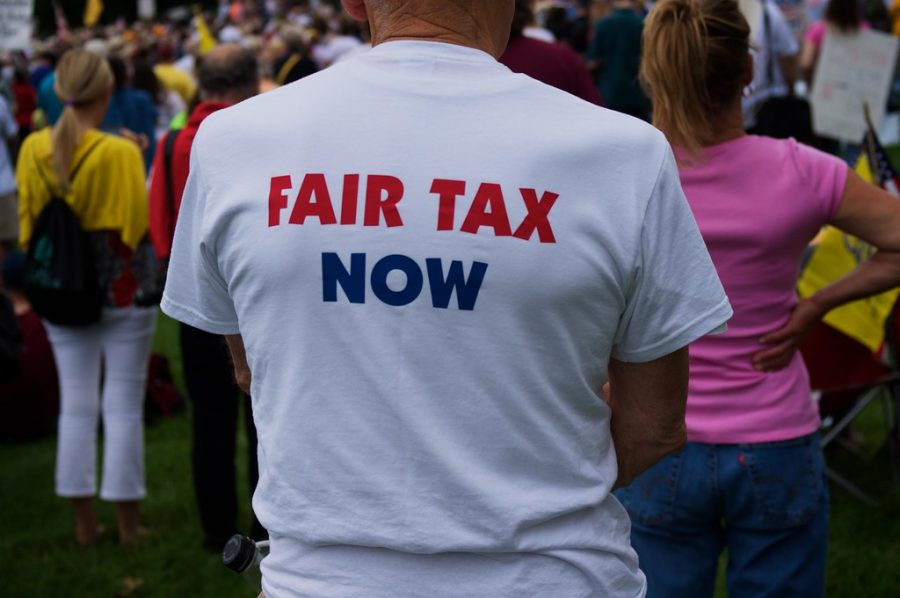 """""""Fair Tax Now"""" by jbouie is licensed under CC BY-NC-ND 2.0"""