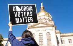 Georgians gather at their state's Capitol building as voter suppression legislation is passed.