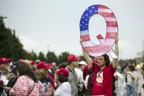 In Wilkes-Barre, PA, QAnon supporters gather outside a Donald Trump campaign rally in August 2018.