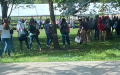 Teachers wait outside tents in Lincoln Park as the votes are tallied