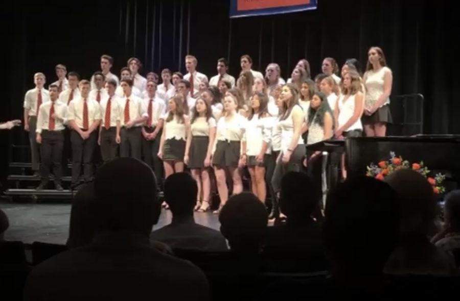 The Upper School Chorus in 2019 performing in the Wrigley Theater.